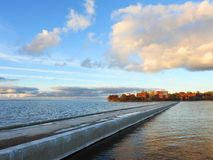 Curonian spit, pier and Lighthouse, Lithuania royalty free stock photo