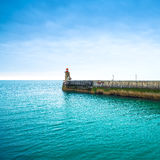 Pier and lighthouse on sunset, Fecamp harbor. Normandy France. Stock Photography