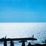 Pier with lighthouse in Yalta city in blue evening Royalty Free Stock Photography