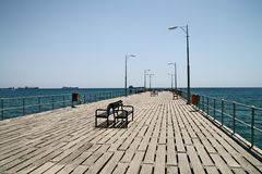 Pier. Limassol, Cyprus. Pier with benches in Limassol, Cyprus Stock Photos