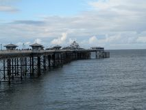 Pier at Llandudno, Wales with blue sky background stock image