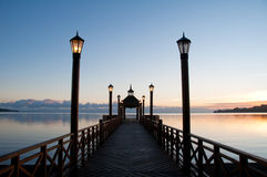 Pier at Llanquihue lake. Sunrise at pier in Llanquihue lake Royalty Free Stock Photos