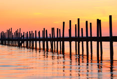 Pier. Long pier taken a bit off with all the poles that hold the pier Royalty Free Stock Photo