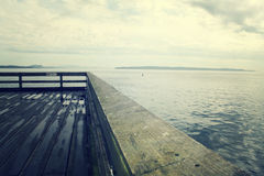 Pier. Looking down pier over Pacific Ocean Royalty Free Stock Photo