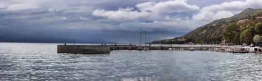 Pier in Loutraki, Greece. Corinthian Gulf, panorama Stock Photos