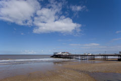 Pier at low tide Royalty Free Stock Photos