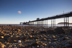 Pier at low tide Stock Image