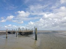 A pier during low tide Stock Photography