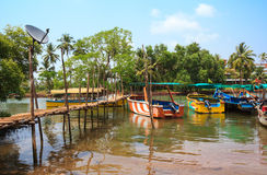 Pier made of bamboo and pleasure boats. Sinquerim-Candolim Boat Owners Association in Goa, India. Stock Photo