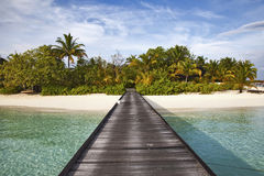 Pier Maldives. Pier , Maldives, beautiful sky and clear water Stock Photos
