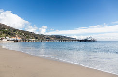 Pier at Malibu Lagoon California. Old wooden pier in ocean by Malibu Lagoon California Royalty Free Stock Photos