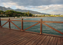 A pier in Marbella beach Stock Images