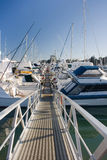 Pier at marina on early morning. Yachts and boats rest in Pine Harbor Marina, Auckland, New Zealand royalty free stock photos