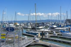 Pier 39 Marina with yachts and boats docking in San Francisco,CA. Sunny Day View of Pier 39 Marina with yachts and boats docking in San Francisco,CA royalty free stock photos