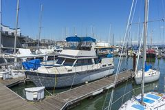 Pier 39 Marina with yachts and boats docking in San Francisco,CA. Sunny Day View of Pier 39 Marina with yachts and boats docking in San Francisco,CA stock images