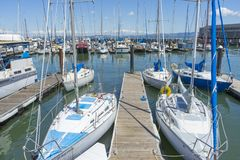 Pier 39 Marina with yachts and boats docking in San Francisco,CA. Sunny Day View of Pier 39 Marina with yachts and boats docking in San Francisco,CA royalty free stock photography