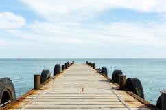Pier. Marine pier, dock ships on the beach Royalty Free Stock Image