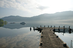 Pier and misty loch Stock Images