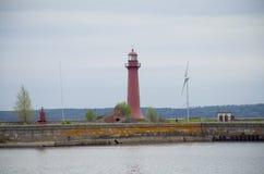 Pier mit dem Leuchtfeuer Kronstadt Russland Lizenzfreie Stockbilder