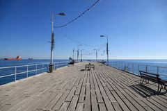 Pier on Molos Promenade at coast of Mediterranean sea, Limassol, Cyprus. Pier on Molos Promenade at the coast of Mediterranean sea, Limassol, Cyprus royalty free stock images