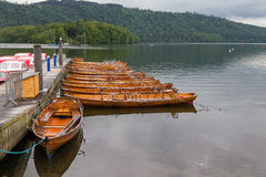 Pier and Moored rwoing boats in Bowness-on-Windermere, UK Royalty Free Stock Images