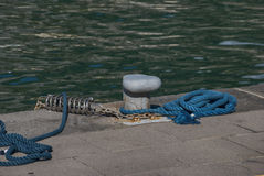 Pier mooring boat. One pier mooring boat with rope royalty free stock photos