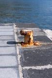 Pier mooring boat. One pier mooring boat rusty stock image