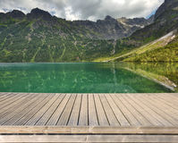 Pier with mountain lake Stock Photography
