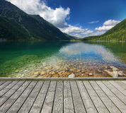 Pier with mountain lake Royalty Free Stock Photos