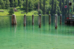 Pier in a mountain lake Stock Photos