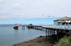 Pier at Mumbles hills. View from the seafront over the pier in Mumbles hill in Wales Royalty Free Stock Image