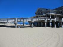 Pier on Nag`s Head beach, North Carolina. Beautiful sunny day and bright blue sea Royalty Free Stock Photo