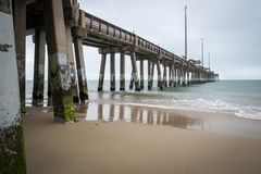 The pier in Nags Head, North Carolina, on a stormy day. The pier in Nags Head on the Outer Banks in North Carolina on a stormy spring day Stock Image