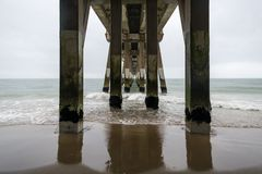 The pier in Nags Head, North Carolina, on a stormy day. The pier in Nags Head on the Outer Banks in North Carolina on a stormy spring day Royalty Free Stock Images