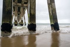 The pier in Nags Head, North Carolina, on a stormy day. The pier in Nags Head on the Outer Banks in North Carolina on a stormy spring day Stock Images