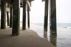 The pier in Nags Head, North Carolina, on a stormy day. The pier in Nags Head on the Outer Banks in North Carolina on a stormy spring day Stock Photography