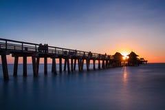 Pier of Naples at sunset. Florida, USA Stock Photos