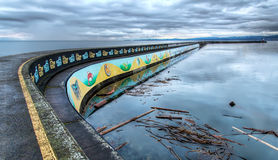 Pier With Native Mural on Side Stock Photography