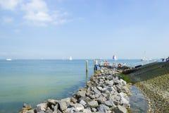 Pier near Marken lighthouse, sunny day Stock Image