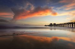 Sunset at Naples Pier royalty free stock photography