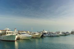 The Pier near sea port of Sochi. White yachts lined up in a row Royalty Free Stock Photos