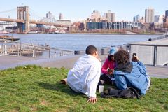 Pier 15. NEW YORK - MARCH 17, 2016: people take a rest at Pier 15 at daytime. Pier 15 is located east of South Street and FDR Drive in Lower Manhattan, New York Royalty Free Stock Photo