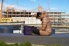 Pier 15. NEW YORK - MARCH 17, 2016: woman take a rest at Pier 15 at daytime. Pier 15 is located east of South Street and FDR Drive in Lower Manhattan, New York Stock Photography
