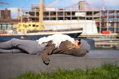 Pier 15. NEW YORK - MARCH 17, 2016: woman take a rest at Pier 15 at daytime. Pier 15 is located east of South Street and FDR Drive in Lower Manhattan, New York Stock Photos