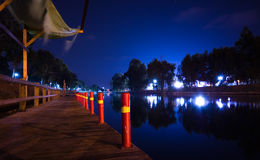 Pier at night. Pier at summer night with red poles Stock Image