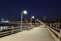 Pier at Night. Leading towards the manhattan skyline Stock Photography