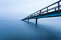 Pier at night. Long pier in calm water in Bjäred, Sweden Stock Photography