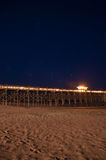 Pier at Night. A Pier on the Beach During a Clear Night stock photography