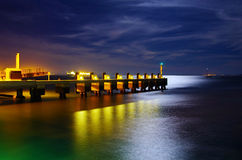 Pier at Night. Calm atmosphere in a pier at night under a bright moonlight Stock Photography
