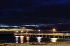 Pier and night lights stock image